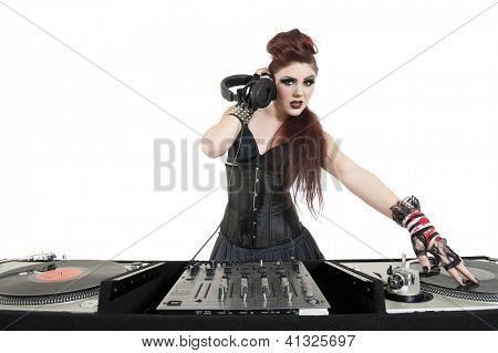 Beautiful young DJ listening to music over white background