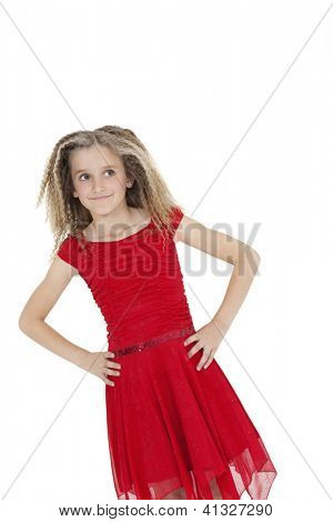 Tilt image of girl in red frock with hands on hips over white background