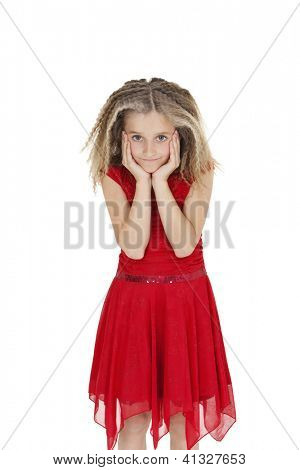 Girl in red frock with head in hands over white background