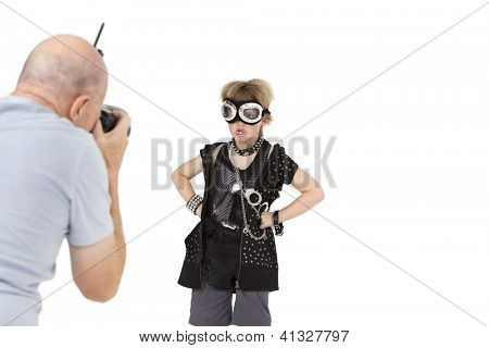 Middle age photographer shooting punk kid over white background