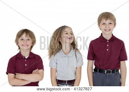 Portrait of cheerful school children in uniform over white background