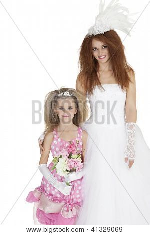 Beautiful bride and bridesmaid holding flower bouquet over white background