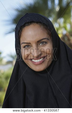 Close up portrait of an Indian woman in burkha smiling