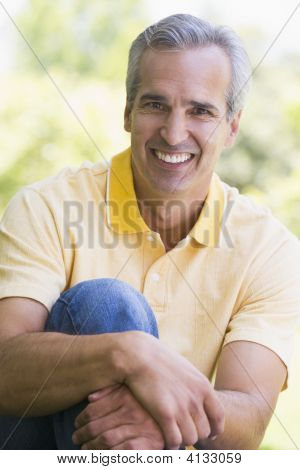 Man Sitting Outdoors Smiling