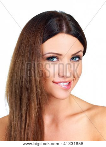 Attractive woman with bare shoulders biting her lip in indecision as she tries to make up her mind isolated on white