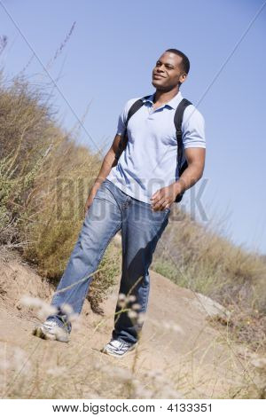 Man Walking A Trail In The Countryside.