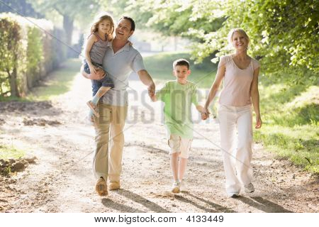 Families Walking Outdoors Holding Hands And Smiling