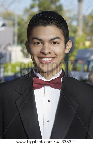 Portrait of a Hispanic groom in tuxedo smiling on his wedding day