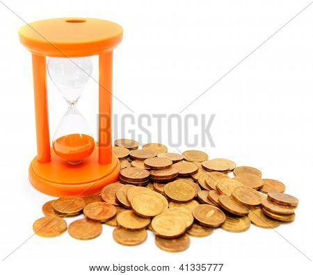 Sand-glass and gold coins. On a white background.