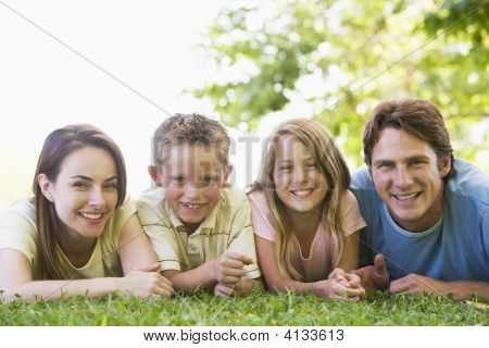 Families Lying Outdoors Smiling