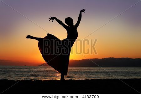 Dancing Woman At Sunset