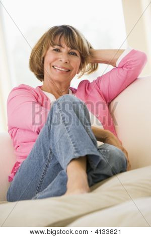 Woman In Living Room Smiling