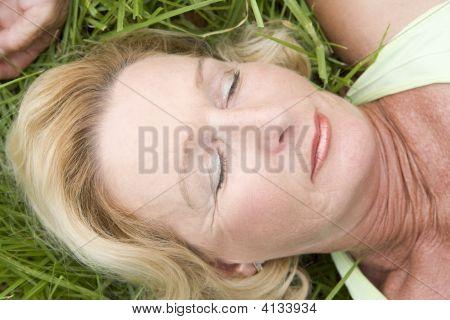 Woman Lying In Grass Sleeping