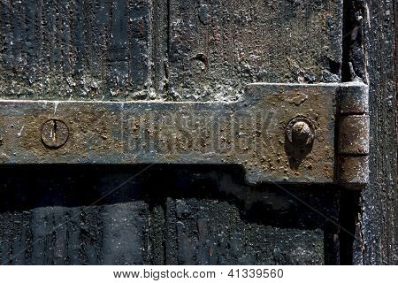 Old Iron Metal Lock Screw And Wood