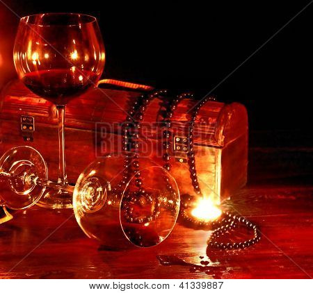 Two wine glass and candle on dark. Still life.