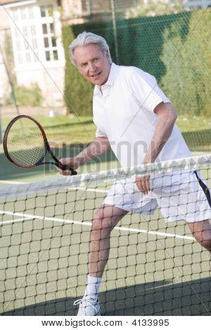 Man Playing Tennis And Smiling