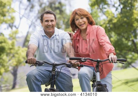 Mature Couples Bike Riding. | Stock photo. download preview; add to cart