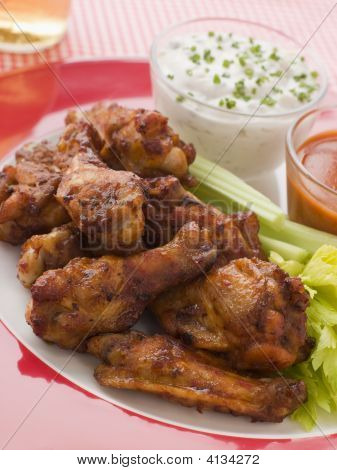 Spicy Buffalo Wings With Blue Cheese Dip Celery And Hot Chilli Sauce