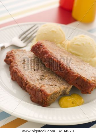 Meatloaf Baked In Tomato Sauce With Mashed Potatoes And Mustard