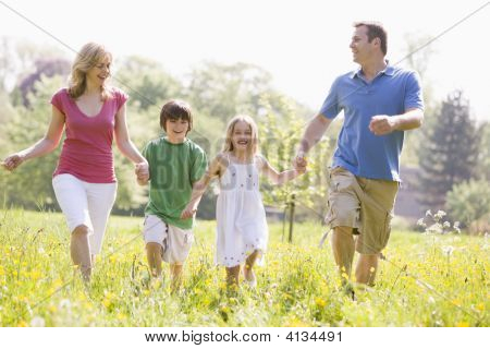 Families Walking Outdoors Holding Hands Smiling