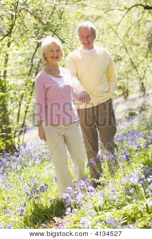 Couples Walking Outdoors Holding Hands Smiling