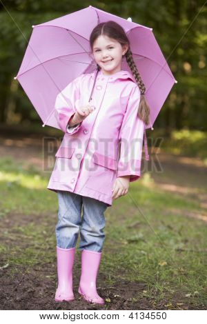 Young Girl Outdoors With Umbrella Smiling