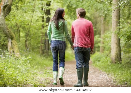 Couples Walking On Path Holding Hands
