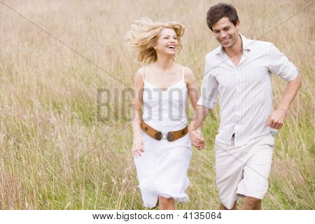 Couples Running Outdoors Holding Hands Smiling