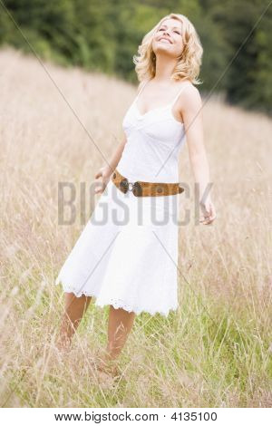 Woman Standing Outdoors Smiling