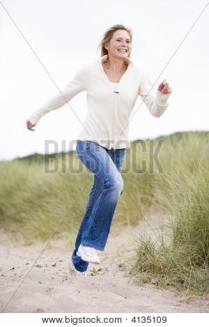 Woman Running At Beach Smiling