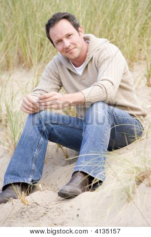 Man Sitting On Beach