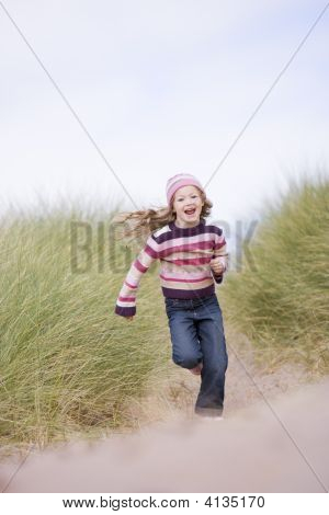 Young Girl Running On Beach Smiling
