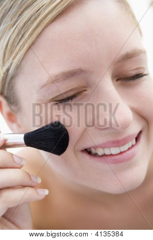 Woman With Makeup Brush Smiling
