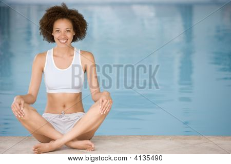 Woman Sitting Poolside Smiling