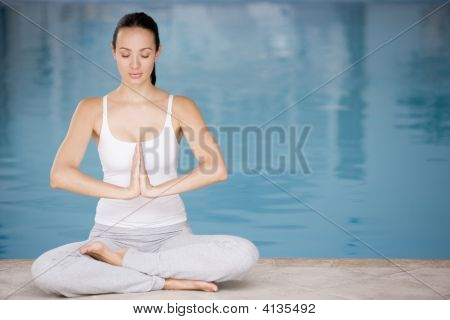 Woman Sitting Poolside Doing