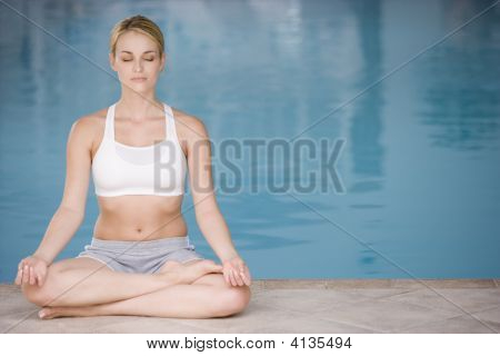 Woman Sitting Poolside Doing