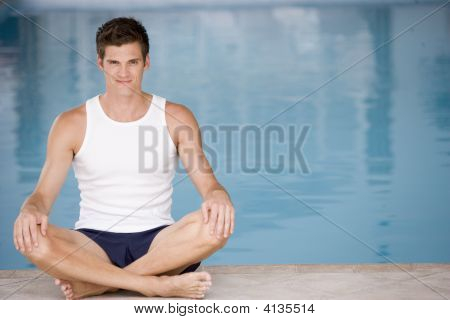 Man Sitting Poolside Smiling
