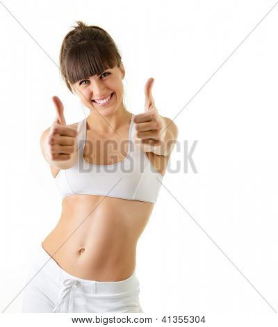 sport young woman with perfect body show victory gesture, fitness girl studio shot over white background