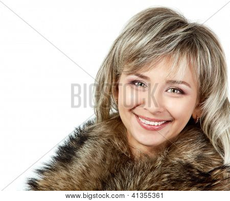 seasonal portrait of cheerful mid adult woman in fur, attractive caucasian 40 years old woman over white