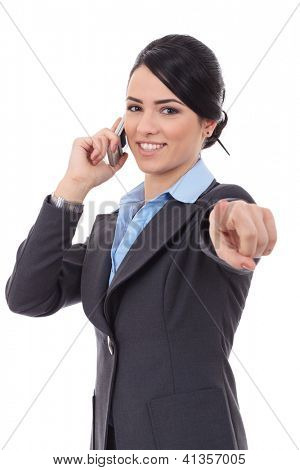 Smiling business woman talking on mobile phone and pointing finger at you