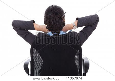 Satisfied business woman with hands crossed behind her head - back picture