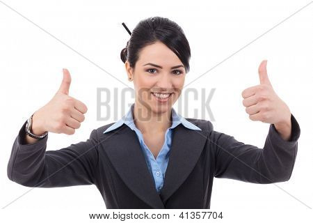 Beautiful young businesswoman making the thumbs up against white background