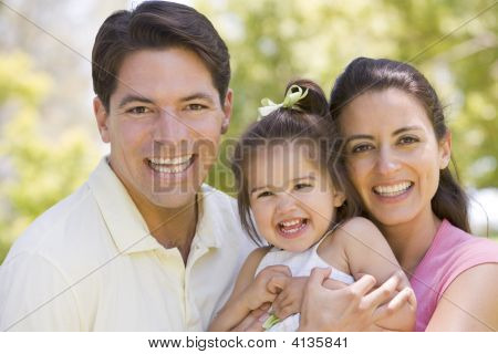 Families Standing Outdoors Smiling