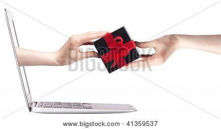 Hand With A Gift And Laptop
