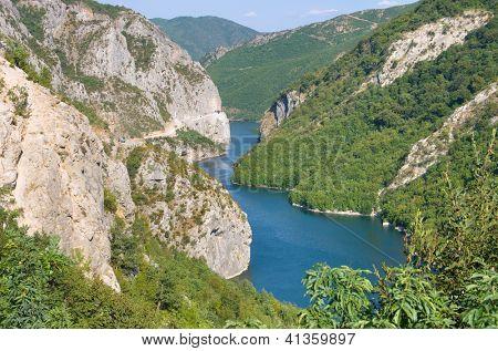 blue water of Koman-Fierza Lake between steep cliffs, Albania