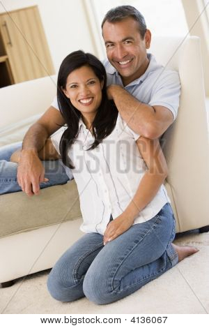 Couples In Living Room Smiling