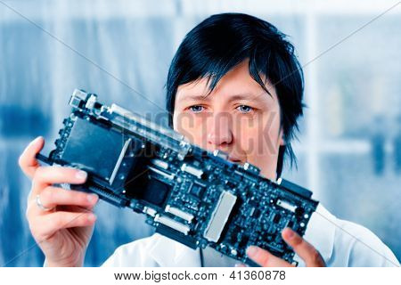 Girl debugging an electronic precision device
