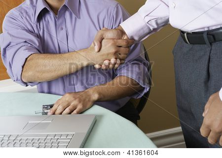 Cropped image of businessmen setting a deal in office