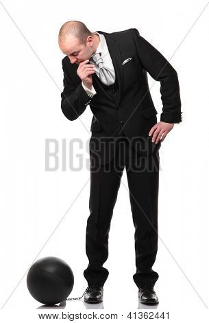caucasian groom with heave ball on his foot