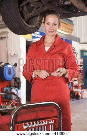 Mechanic Working Under Car Smiling